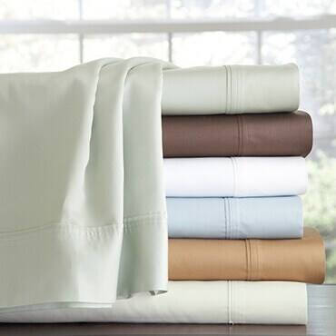A stack of 500 thread count egyptian cotton extra deep pocket sheets