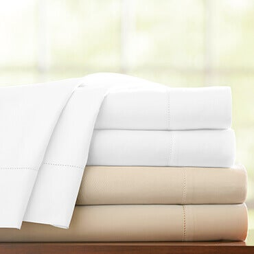 A stack of 1000 thread count cotton sateen sheet set