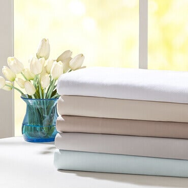 A stack of pre-shrunk percale sheets