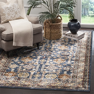 Blue and ivory traditional rug