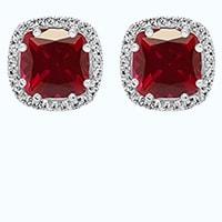 Cushion cut ruby earring in a halo setting
