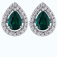 Pear shaped emeral earrings in a halo setting