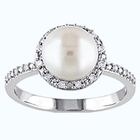 White pearl in a diamond halo silver ring