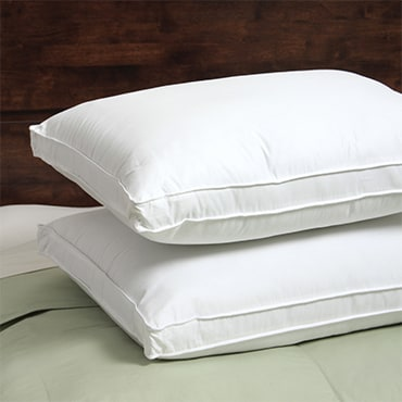 Close up of two white pillows on top of one another