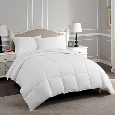 White down alternative comforter on a bed