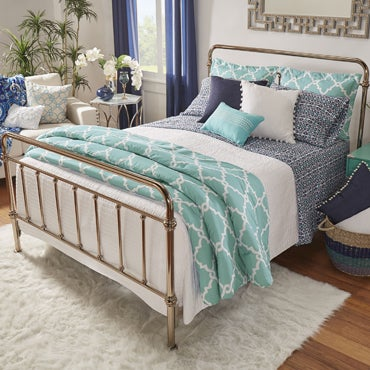 Bed featuring a neutral striped bedding