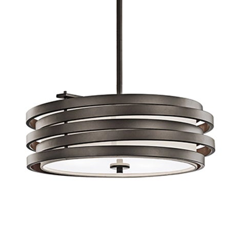 A curved bronze metal pendant light