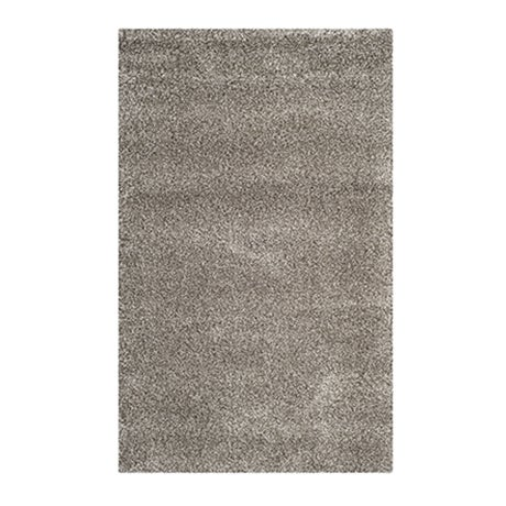 A grey shag textured area rug