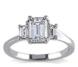 Three emerald shaped stone white gold ring