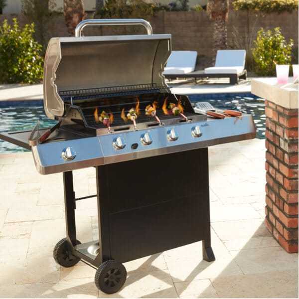 A BBQ grill with grilling accessories