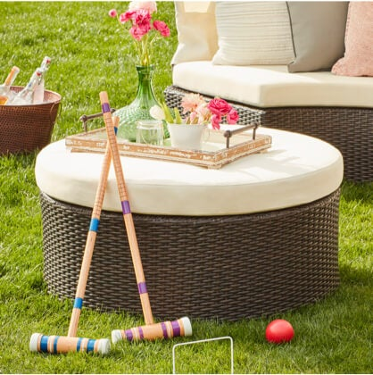 A collection of yard games and party essentials; pool toys, a fire pit, and a lawn games