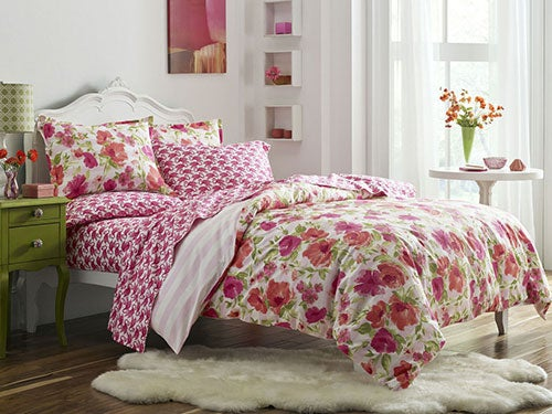 Design a pretty bedroom with floral bedding