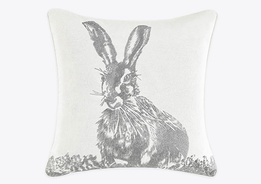 A throw pillow with an easter bunny on it