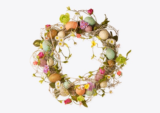 A wreath with easter eggs around it