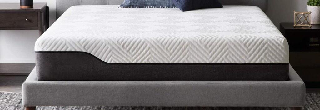 King size mattress in blue bedframe