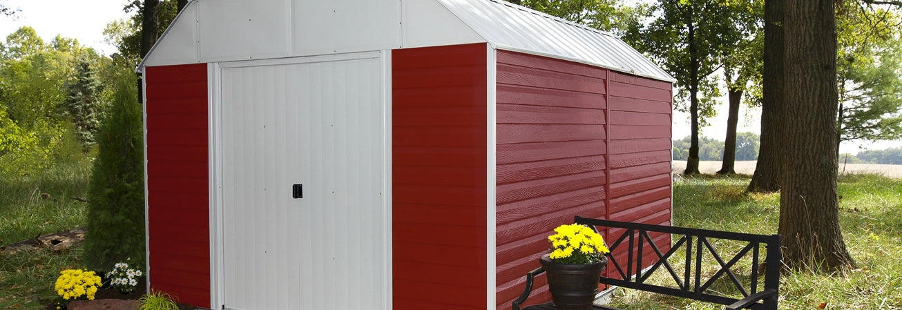 Red and white metal storage shed