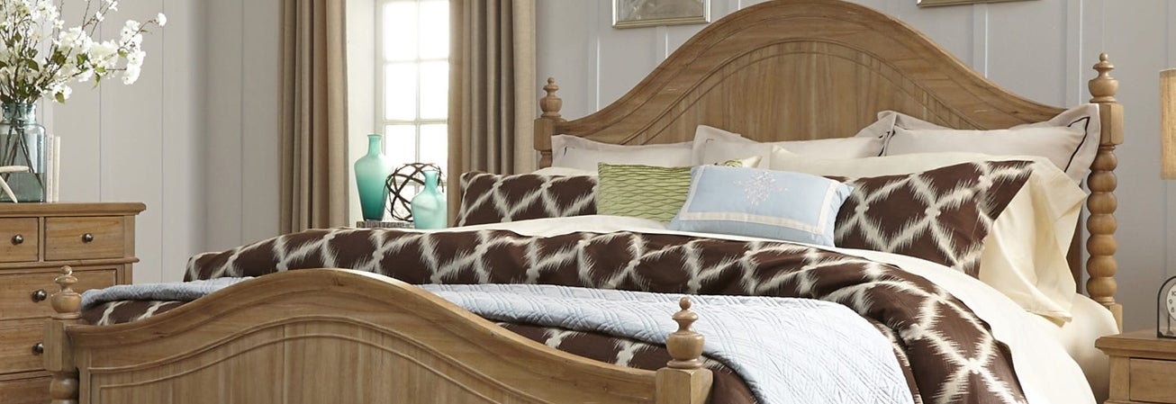 White washed wood poster bed