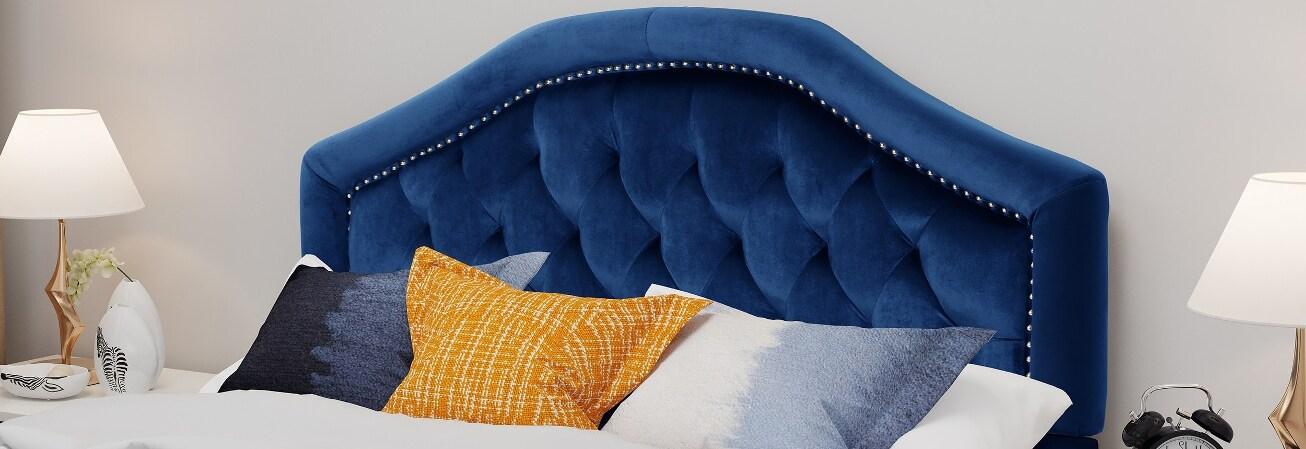 Blue velvet tufted headboard