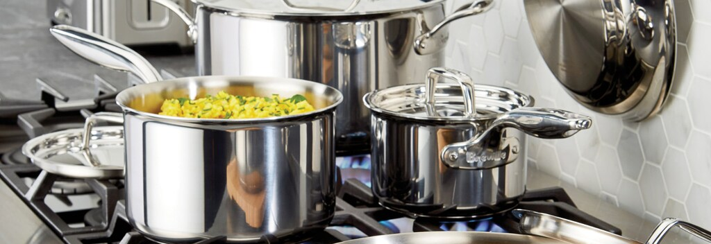 Stainless steel cookware cooking on stovetop
