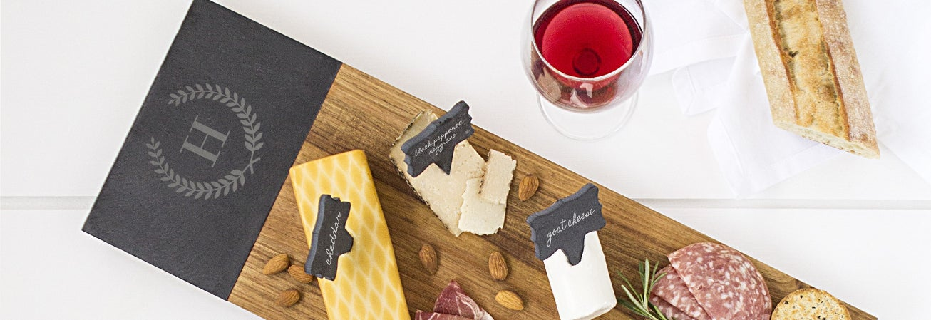 Long cutting board with cheeses and meats