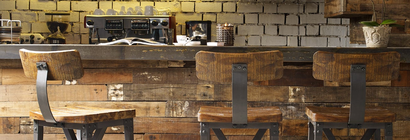 Industrial chairs at an industrial bar with reclaimed wood