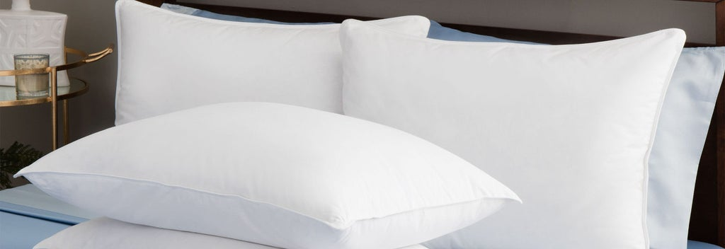 Pile of pillows on a bed