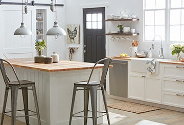 Kitchen with tall, rustic metal chair at a butcher-board kitchen island