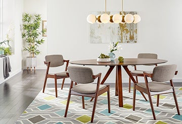 Modern living room with a round table, upholstered chairs and geometric accents