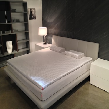 Memory foam topper and pillows on bed