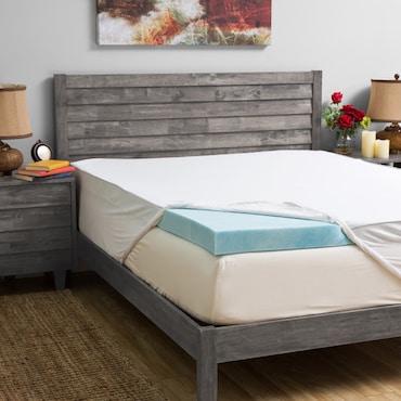Gel memory foam mattress topper on mattress