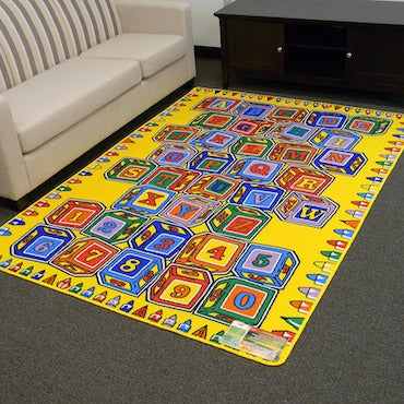 Yellow Area Rug with Lettered Blocks