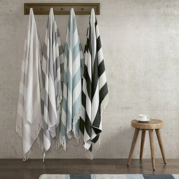 White stripped throws hanging from hooks