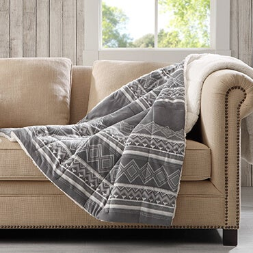 Woolrich down alternative throw with grey  and white print