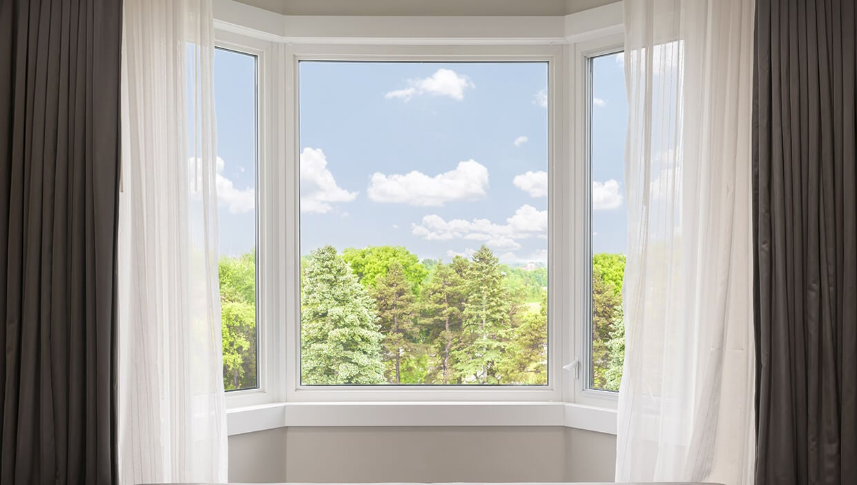 the best ways to hang bay window curtains