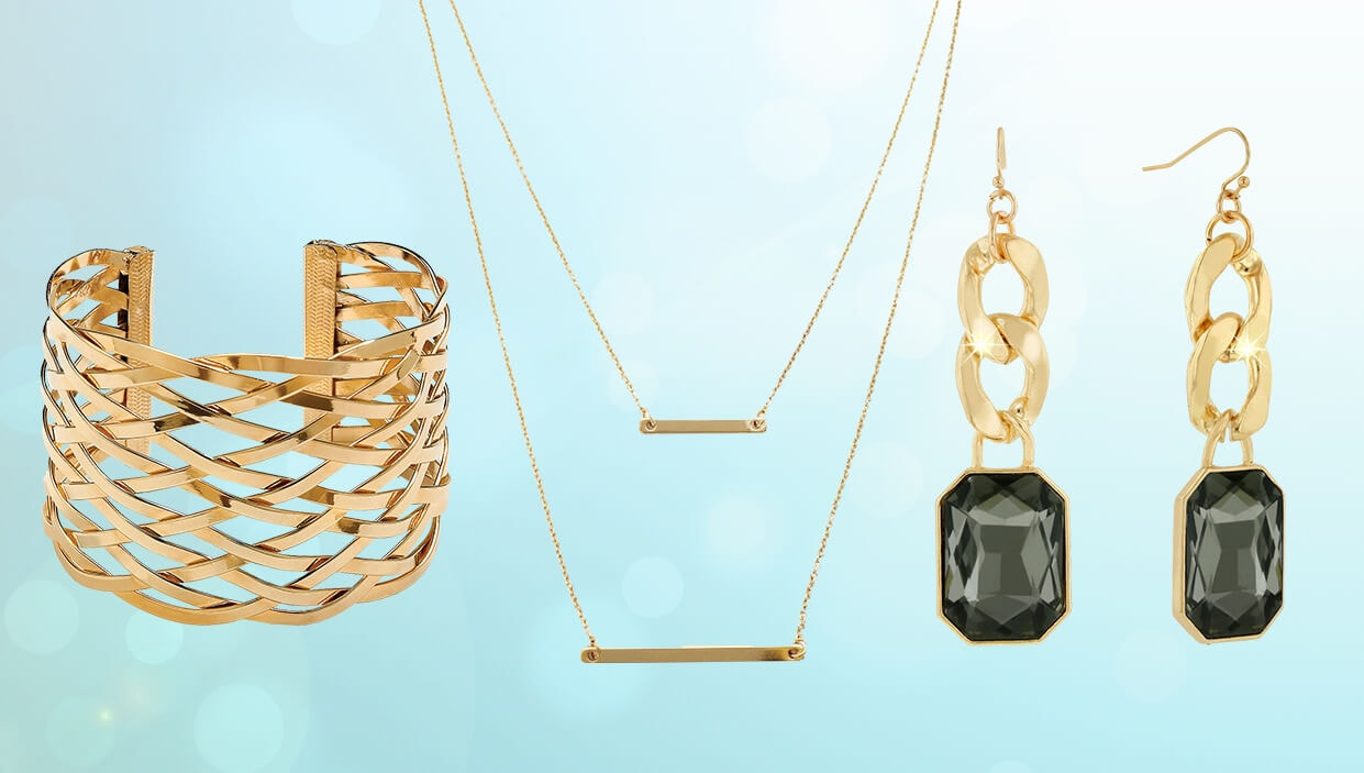 A collage of gold-plated jewelry; a necklace, a bracelet, and a set of earrings.