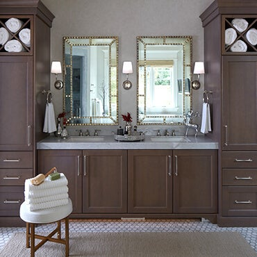Double vanity with two mirrors and bathroom accessories with storage cabinets on each side