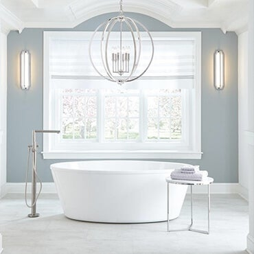 Silver Chandelier hanging above a bath tub