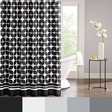 Black and white shower curtain shown in bathroom with a black and white color palette