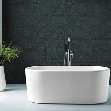 White freestanding bath tub in bathroom