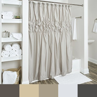 Grey shower curtain shown in bathroom with  netural tone color palette