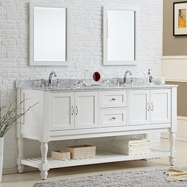 Double white vanity sinks shown in bathroom with cabinets