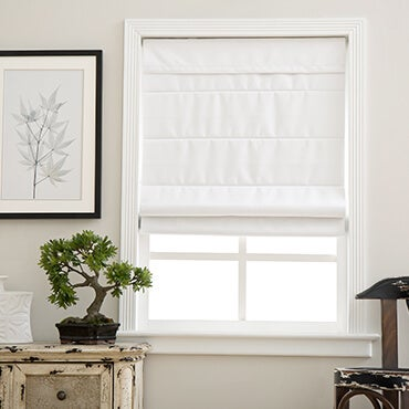 Close up of white cordless Roman shade on window