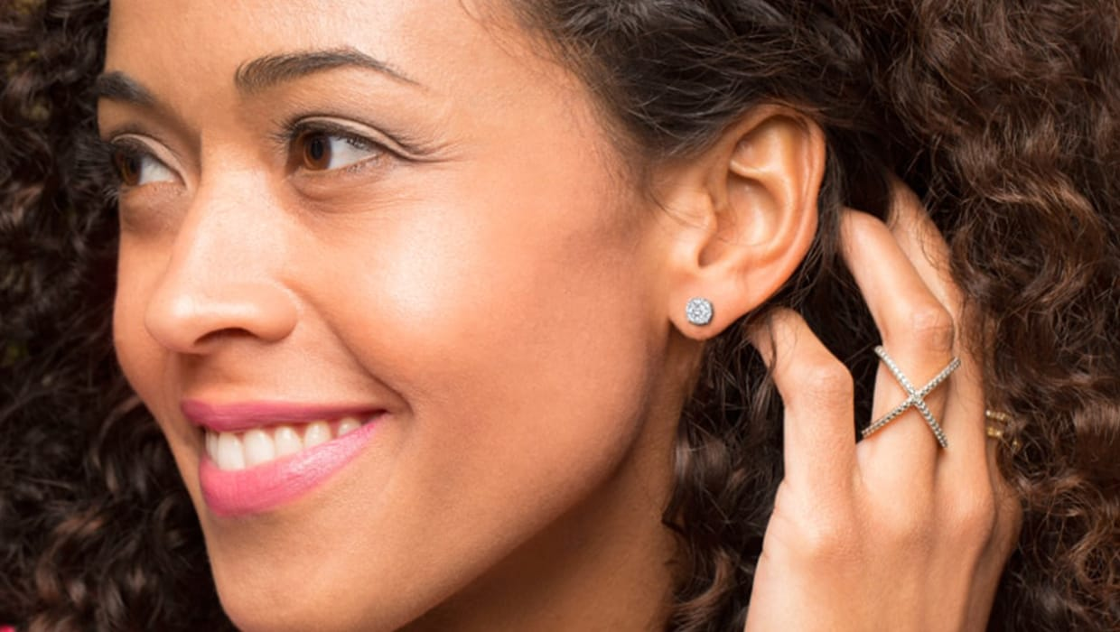 Close up of women's ear with a diamond stud earring