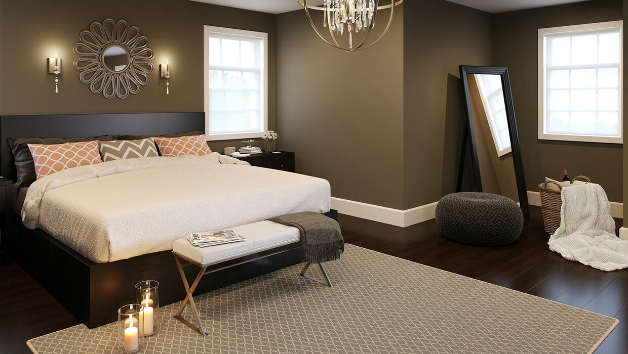 beautifully furnished bedroom featuring gold and crystal wall sconces and chandelier