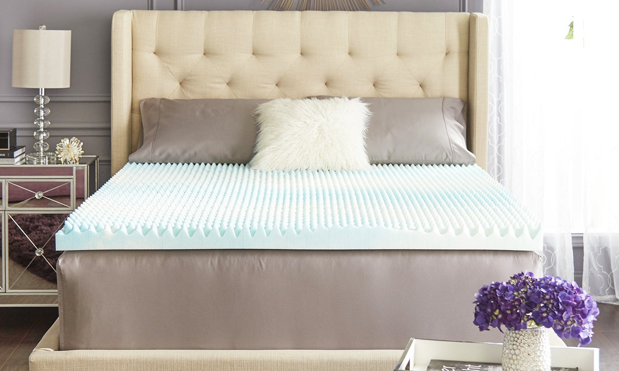 Close up of bed in bedroom with gel memory foam topper