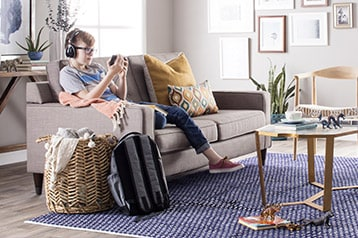 Living room with area rug and boy playing