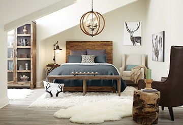 Bedroom heavy with wooden accents and fur rugs