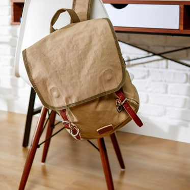 brown backpack on chair