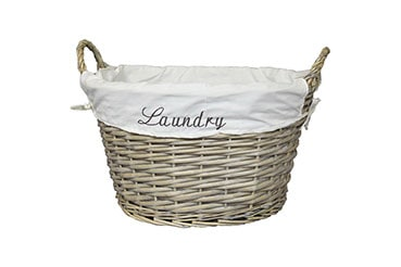 oval, wicker laundry basket with white fabric lining