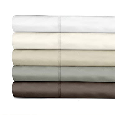 Stack of neutral toned Egyptian cotton sheets
